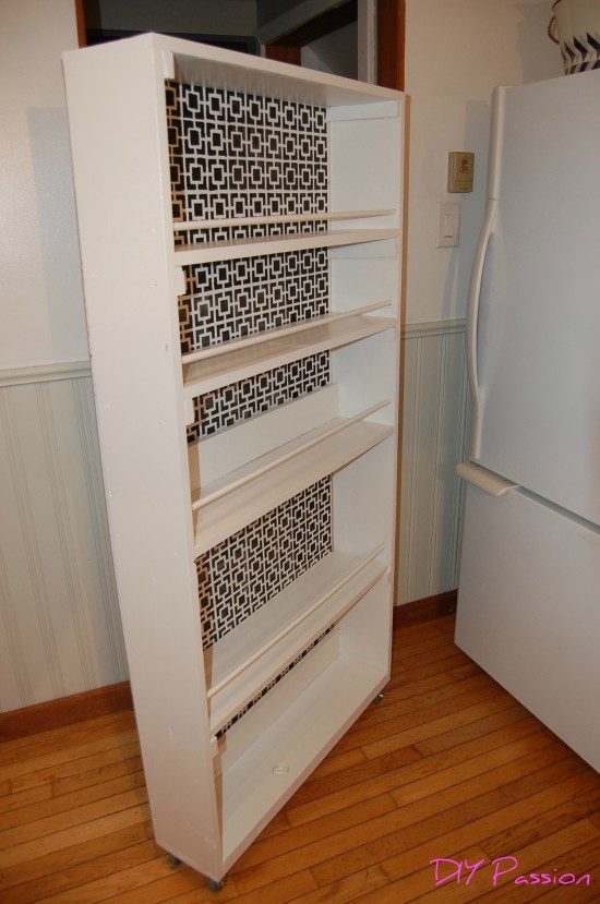 Rolling Pantry 19, spice rack between refrigerator and wall