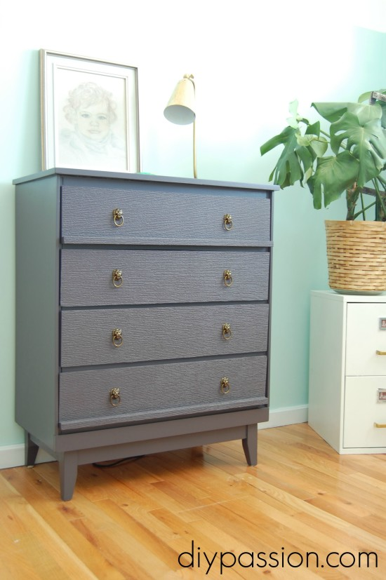Dresser updated with Brass Lion Head drawer pulls and textured wallpaper