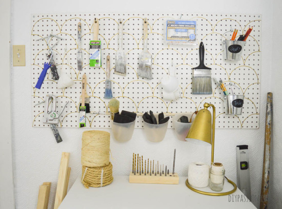 Studio Pegboard with paint supplies