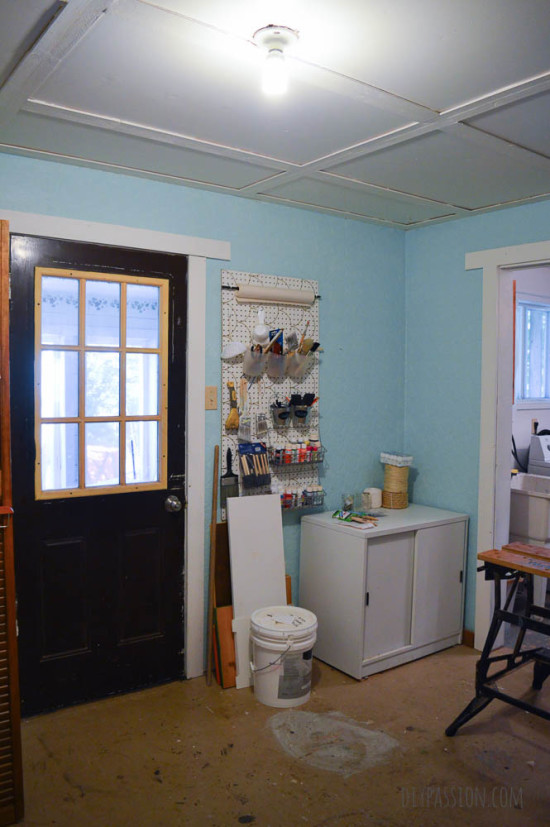 Studio Space Before with Black Door and Blue Walls