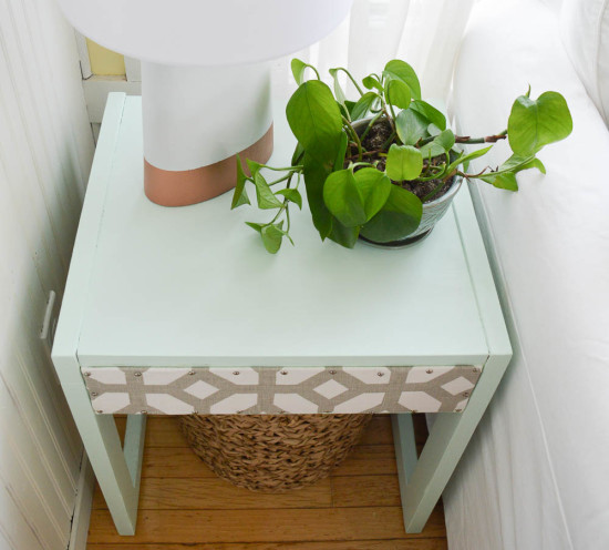 Reclaim a table with paint and fabric