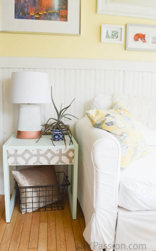 Sunroom with wood wainscoting and yellow paint