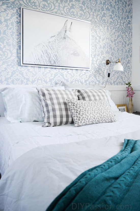 Black and White Horse Art anchors the bed
