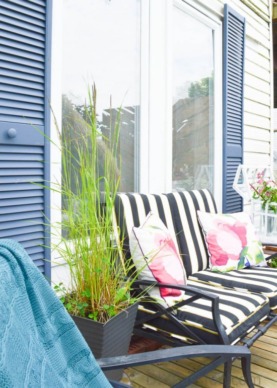 Inexpensive landscape with tall grass on a gold side table