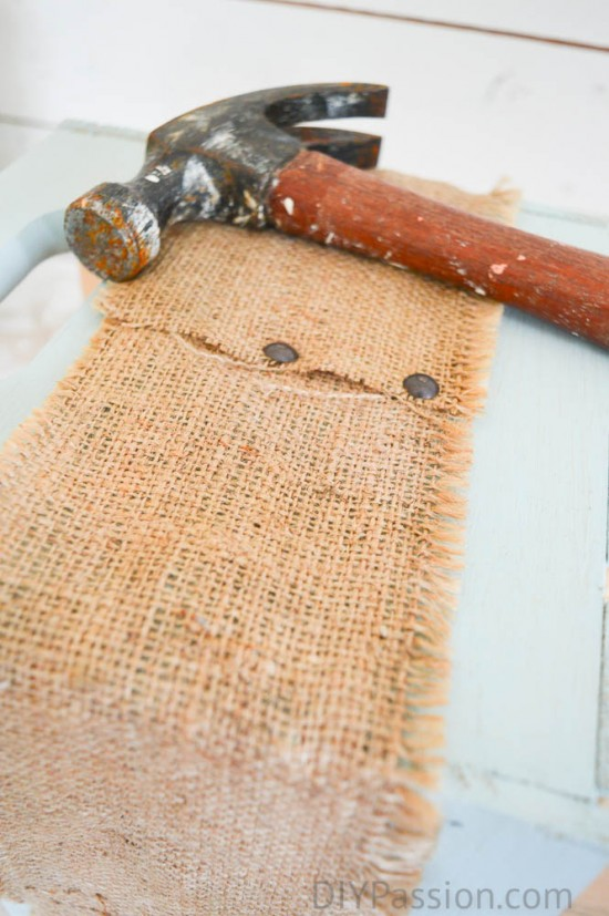 Use upholstery tacks to attach burlap to bin
