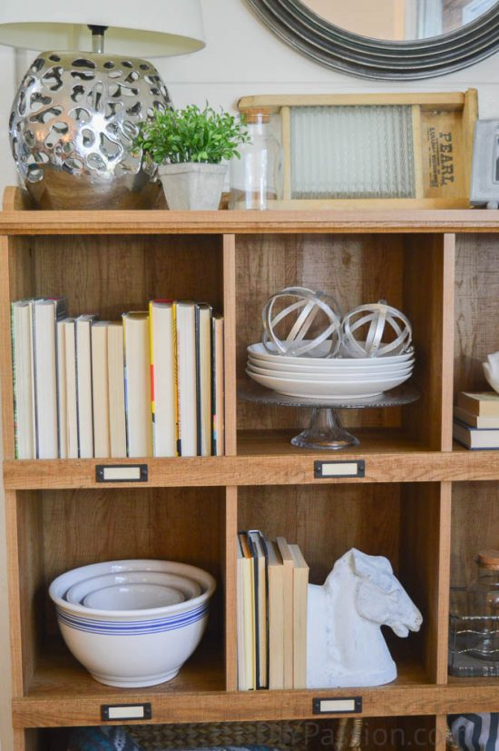 wood-shelf-with-metal-label-holders-how-to-style-a-rustic-bookcase