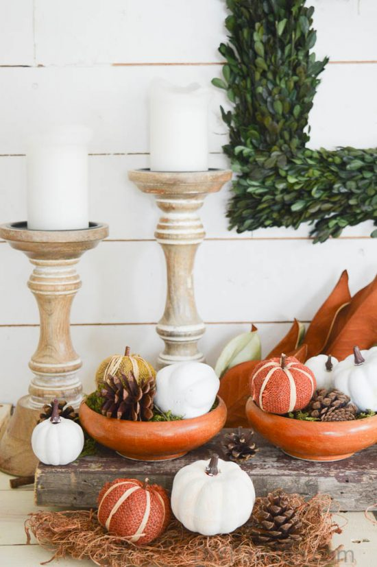 Faux pumpkins, pinecones and reclaimed wood centrepiece