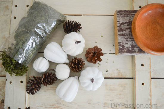 Painted Dollar Store Pumpkins as decoration on a Reclaimed Wood Centrepiece