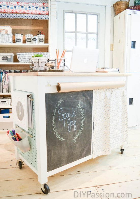 bright-and-lively-basement-craft-room-with-diy-craft-cart