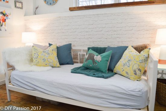 Add patterned pillows to anchor the daybed