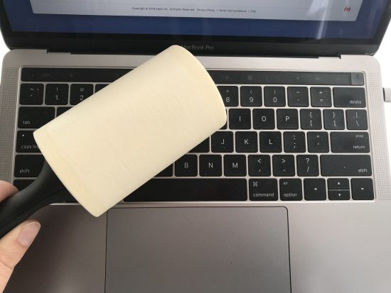 lint roller on a laptop