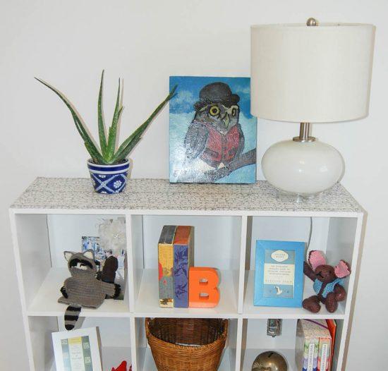 fabric wrapped white ikea bookshelf