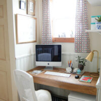Small office nook in hallway with built in desk