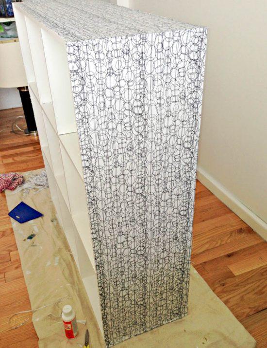decoupage fabric onto the side of a shelf