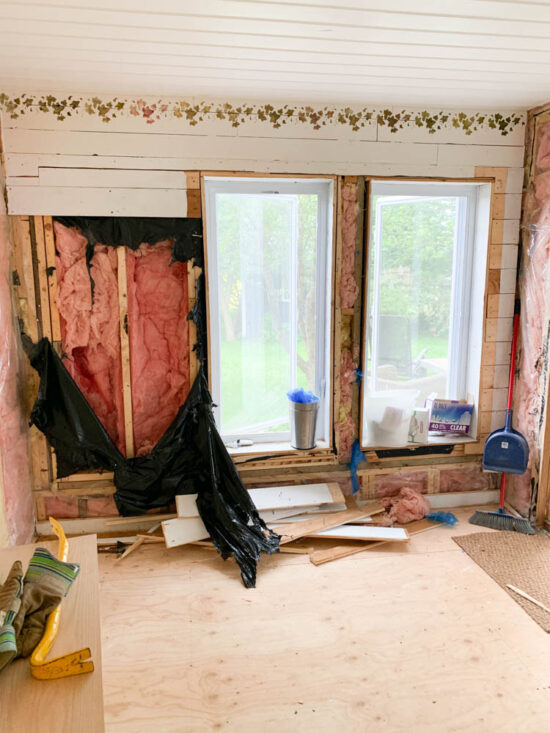enclosing a porch for a living space; insulating the walls of the patio
