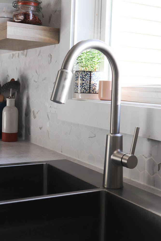 gooseneck faucet with window in the background
